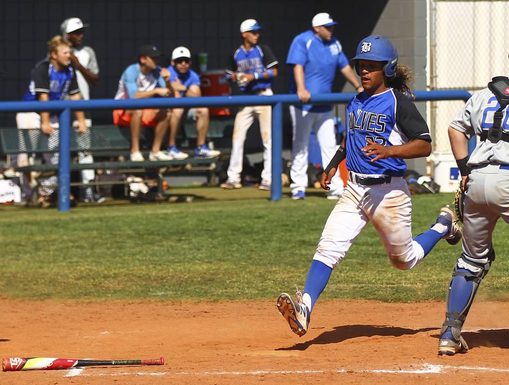 Basic's Christian Rivero (32) scores a run against Santa Margarita during a baseball g ...