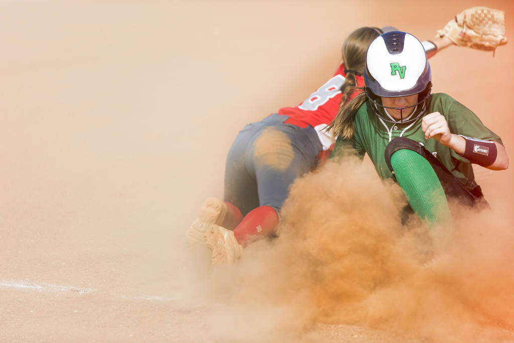Palo Verde's Makena Martin, right, slides into third base successfully as Arbor View&# ...