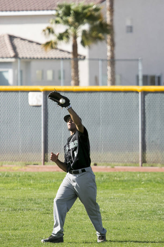 Rancho junior Joseph Walls (14) catches the ball in the outfield during a game against Silve ...