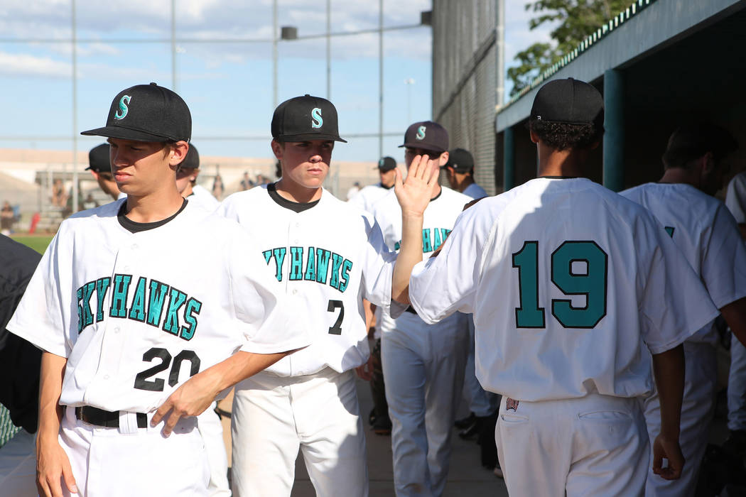 Silverado teammates high-five after an inning during a game against Rancho at Silverado High ...