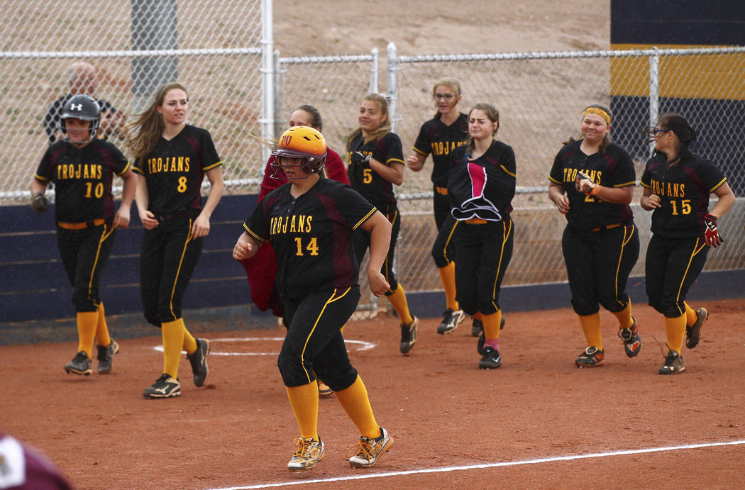 Pahrump's Jordan Egan (14) is cheered on as she rounds out her home run during a softb ...