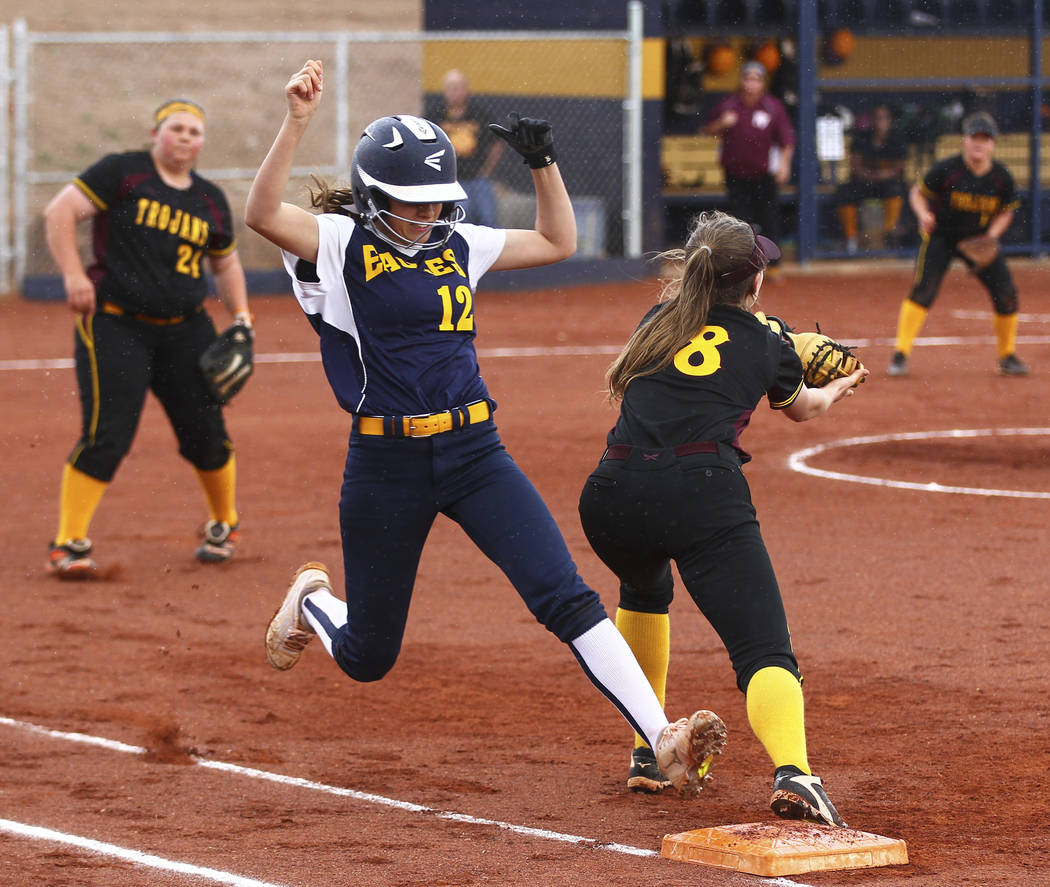 Boulder City's Summer Coyle (12) is tagged out at first base by Pahrump's Jill S ...