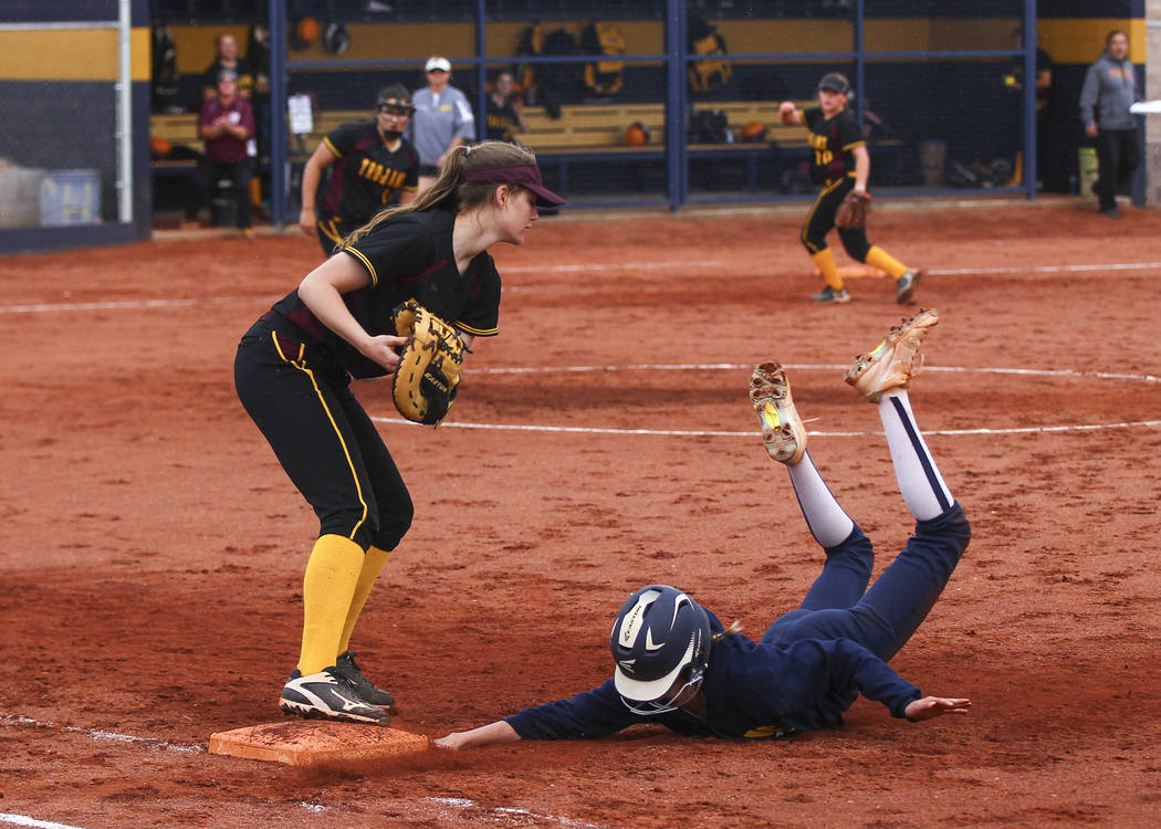 Pahrump's Jill Smith (8) tags out Boulder City's Ellie Ramsey (3) at first base ...