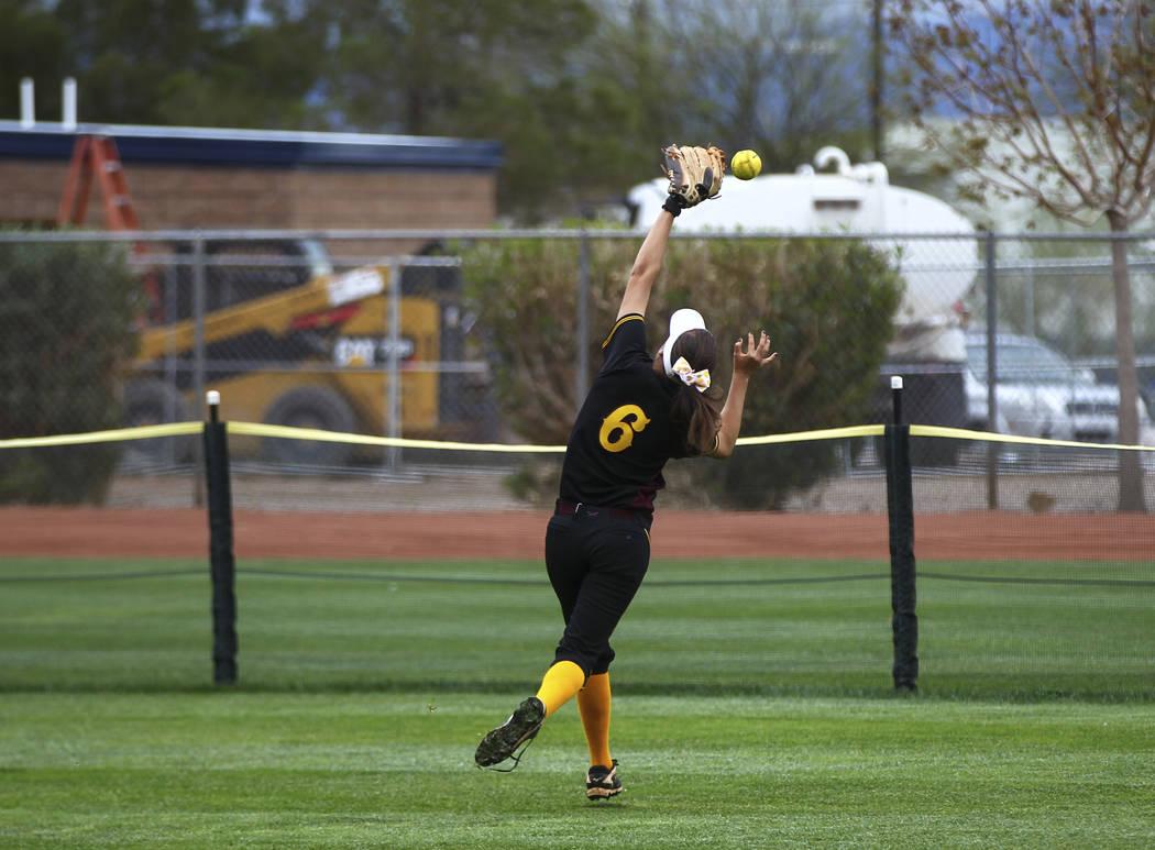 Pahrump's Amaya Mendoza (6) misses a fly ball during a softball game at Boulder City H ...