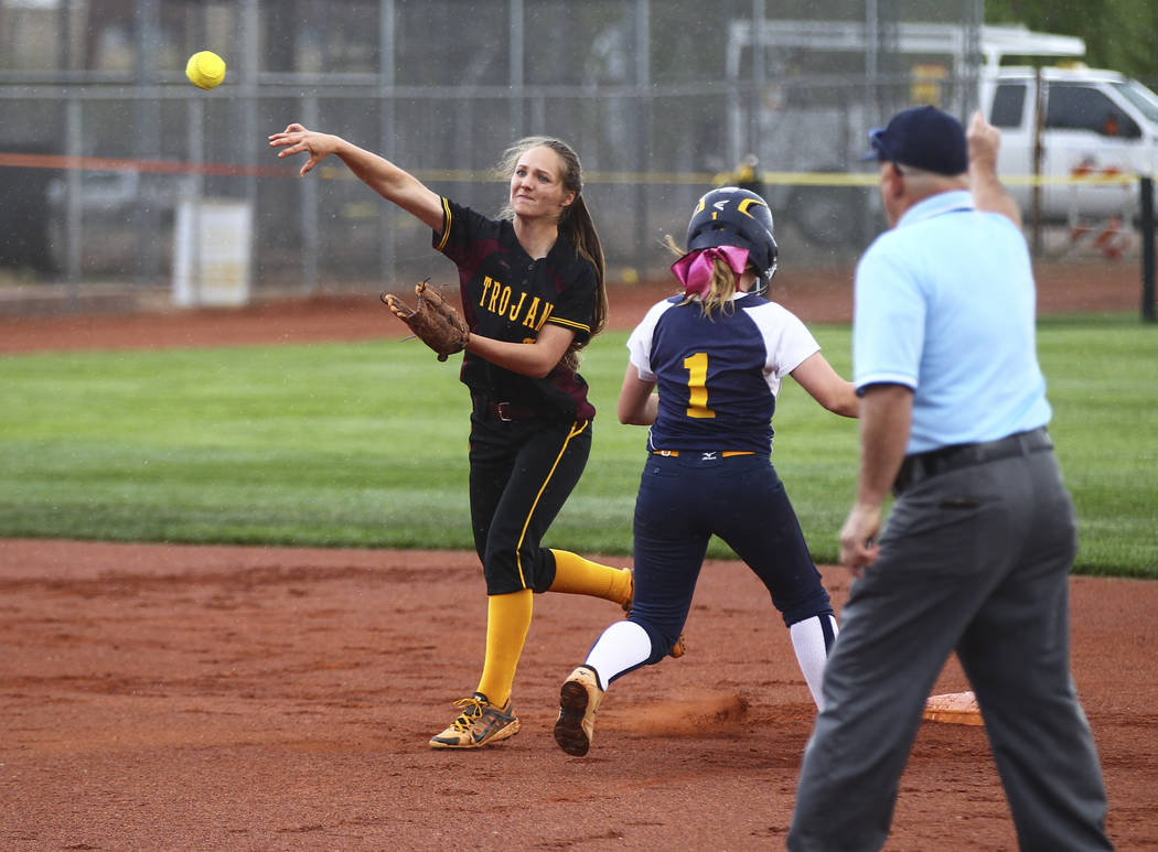 Pahrump's Jackie Stobbe (13) throws to first base after tagging out Boulder City&#8217 ...