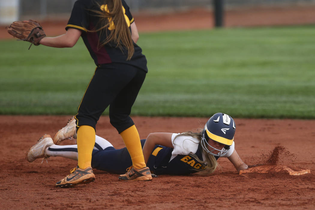 Boulder City's Ashley Wishard (8) makes it safely back to second base during a softbal ...
