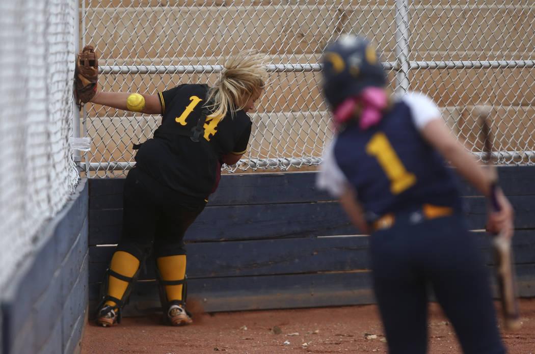 Pahrump's Jordan Egan (14) misses a foul ball from Boulder City's Ellie Ramsey ( ...