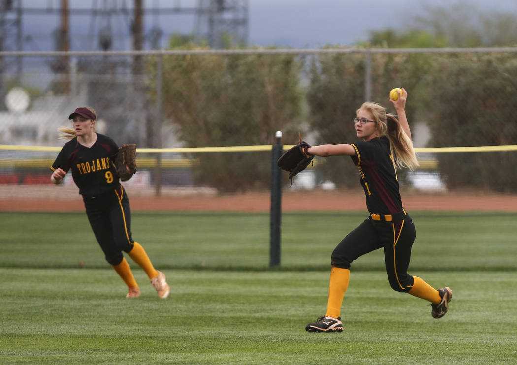 Pahrump's Terrena Martin (1) looks to throw after catching a fly ball from Boulder Cit ...