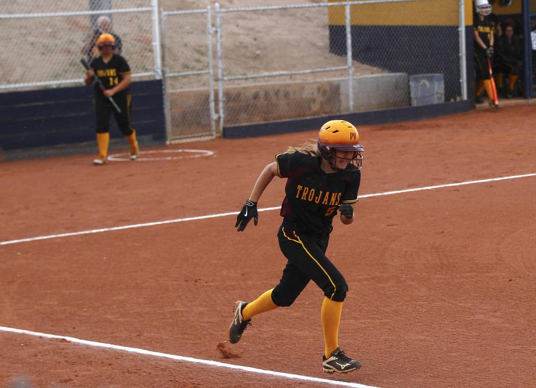 Pahrump's Skyler Lauver (5) runs for first base during a softball game at Boulder City ...