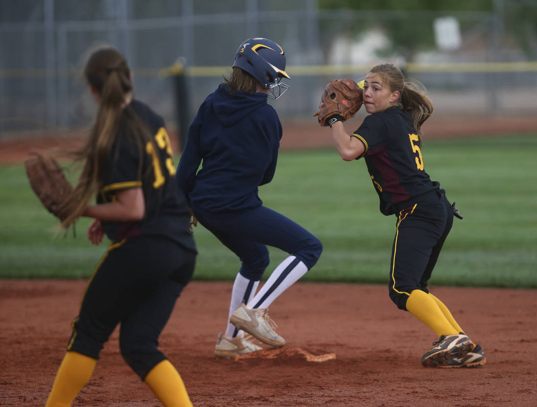 Pahrump's Skyler Lauver (5) looks to throw after tagging out Boulder City's Raeg ...