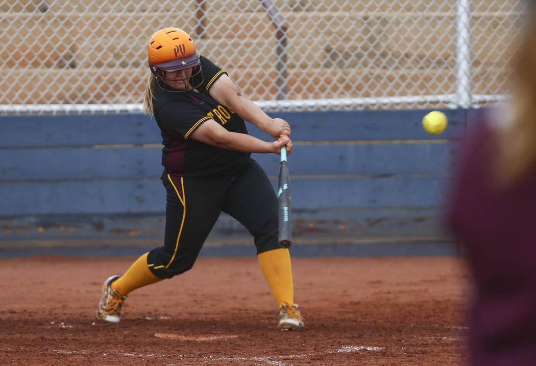 Pahrump's Jordan Egan (14) hits the ball during a softball game at Boulder City High S ...