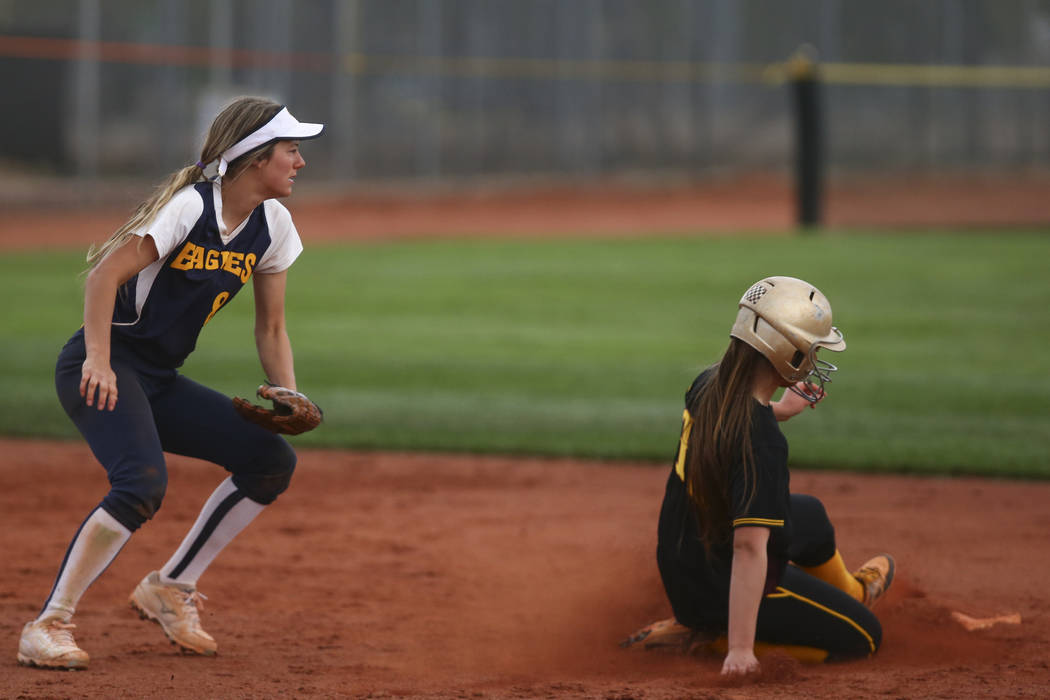 Pahrump's Jackie Stobbe (13) slides into second base past Boulder City's Ashley ...