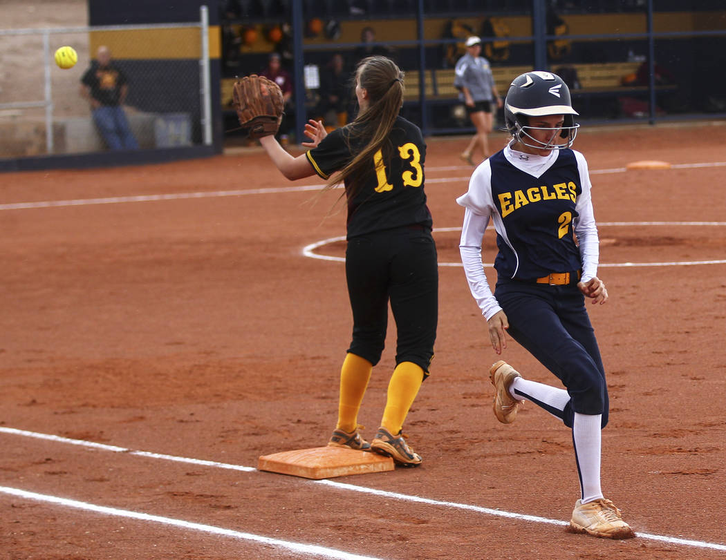 Boulder City's Ryann Reese (2) makes it safely to first base against Pahrump's J ...