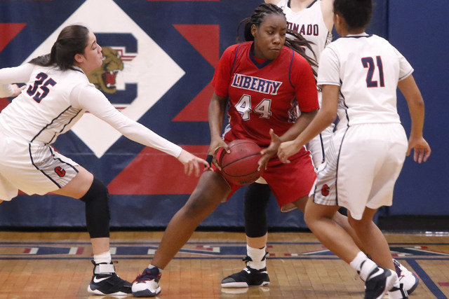 Liberty junior Dre'una Edwards (44) looks for a shot during a basketball game on Tuesd ...