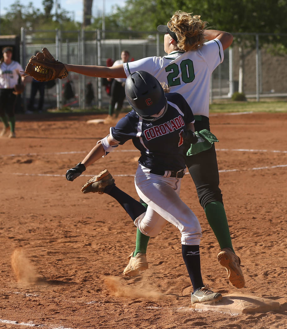 Coronado's Erica Hardy (1) makes it to first base against Rancho's MacKenzie Per ...
