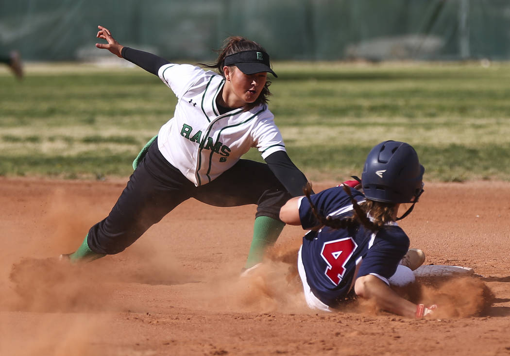 Rancho's Lili Gutierrez (6) tags out Coronado's Dylan Underwood (4) at second ba ...