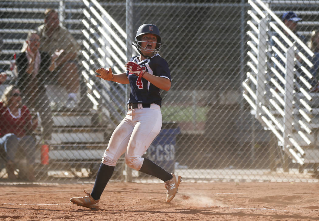Coronado's Dylan Underwood (4) scores a run during a softball game at Rancho High Scho ...