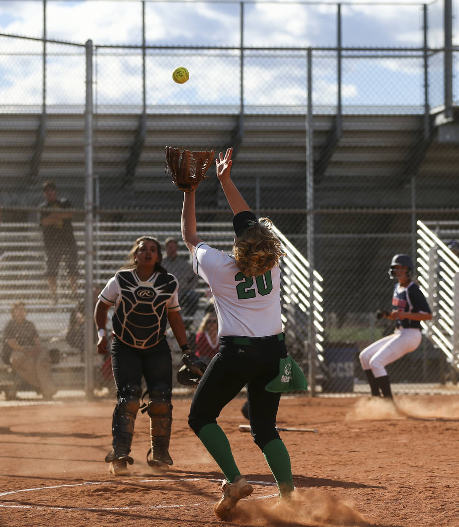 Rancho's MacKenzie Perry (20) catches a foul ball hit by Coronado's Sophia McCan ...