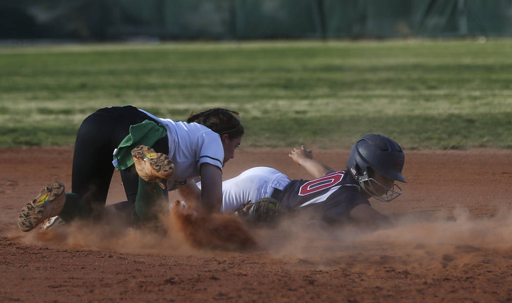 Coronado's Taylor Okamura (10) avoids getting tagged out by Rancho's Gianna Caro ...