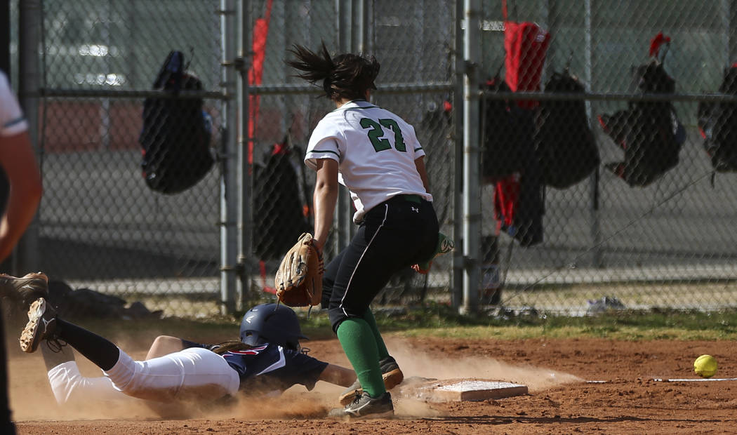 Coronado's Tatum Spangler (5) slides back into third base to stay safe as Rancho&#8217 ...
