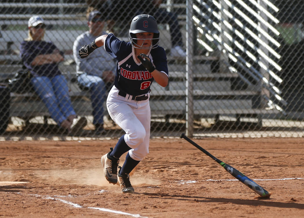 Coronado's Marissa Kopp (8) runs for first base after bunting the ball during a softba ...