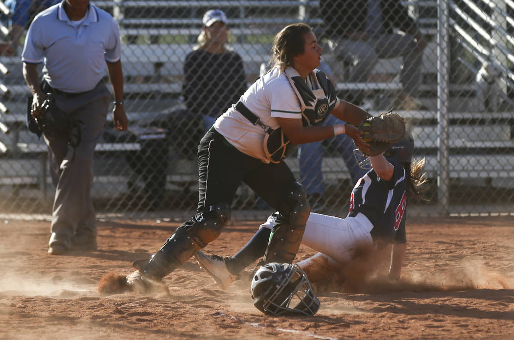 Rancho's Yvette Sanchez (15) tags out Coronado's Marissa Kopp (8) at home base d ...