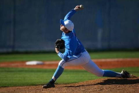 Centennial's Garrett Holden (21) pitches to Cimarron-Memorial during a baseball game a ...