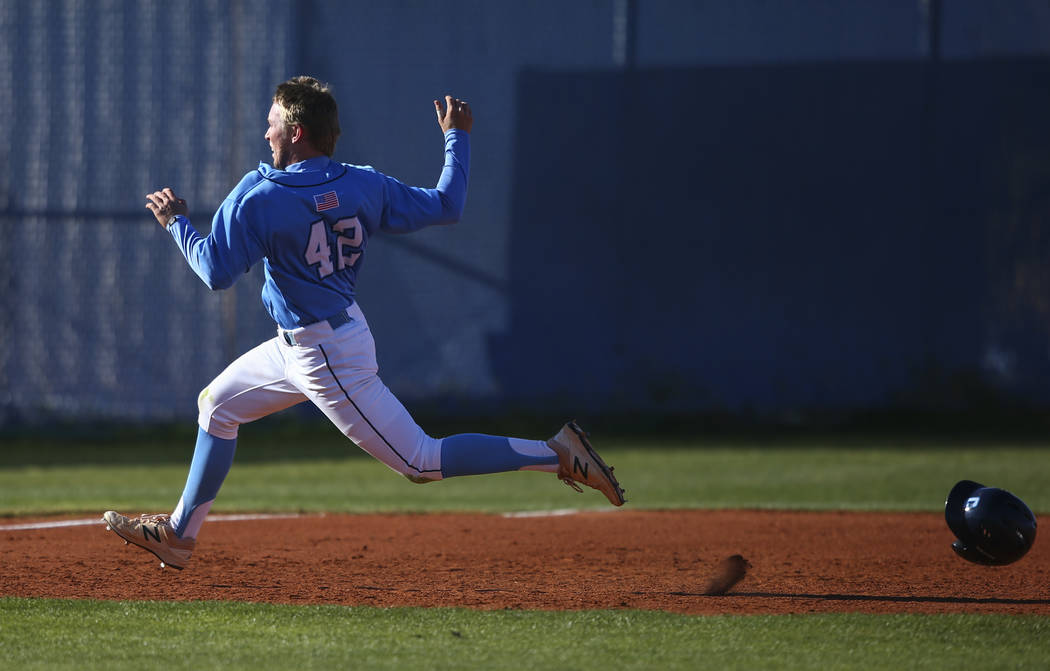 Centennial's Jake Rogers (42) heads for third base during a baseball game against Cima ...