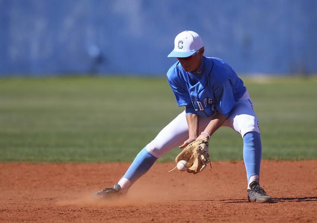 Centennial's Nik Dobar (2) fields a grounder from Cimarron-Memorial during a baseball ...