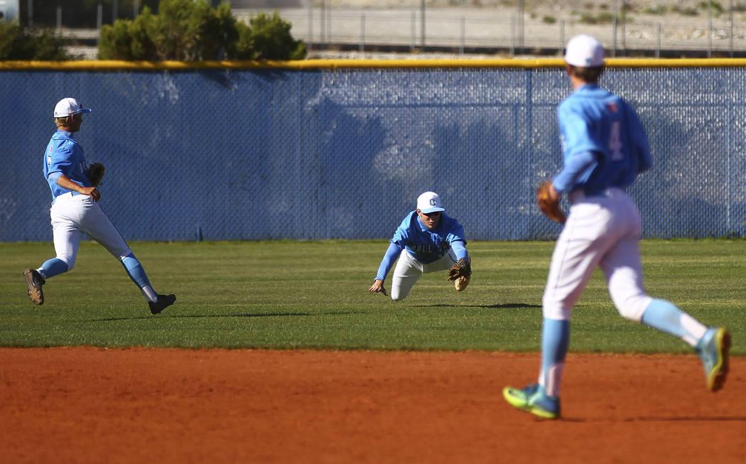 Centennial's Jake Rogers (42), center, catches a fly ball from Cimarron-Memorial&#8217 ...