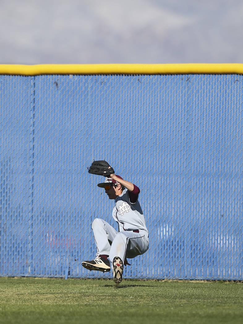 Cimarron-Memorial's Jack Kannon (12) catches a fly ball from Centennial's Kyle H ...