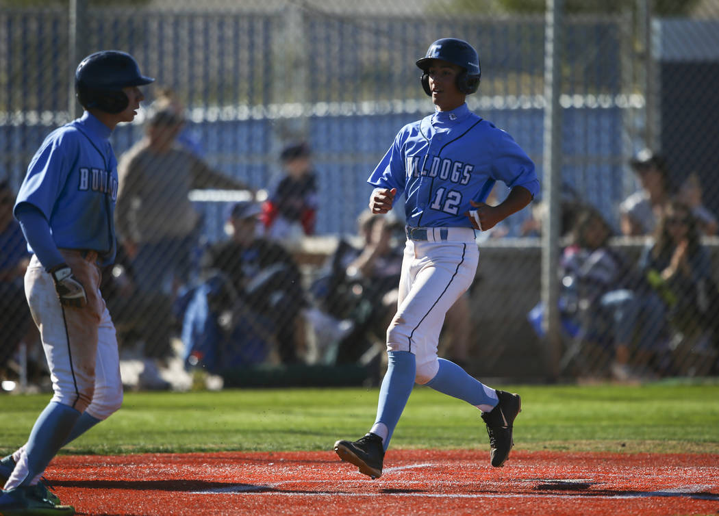 Centennial's Gino Sabey (12) scores a run against Cimarron-Memorial during a baseball ...