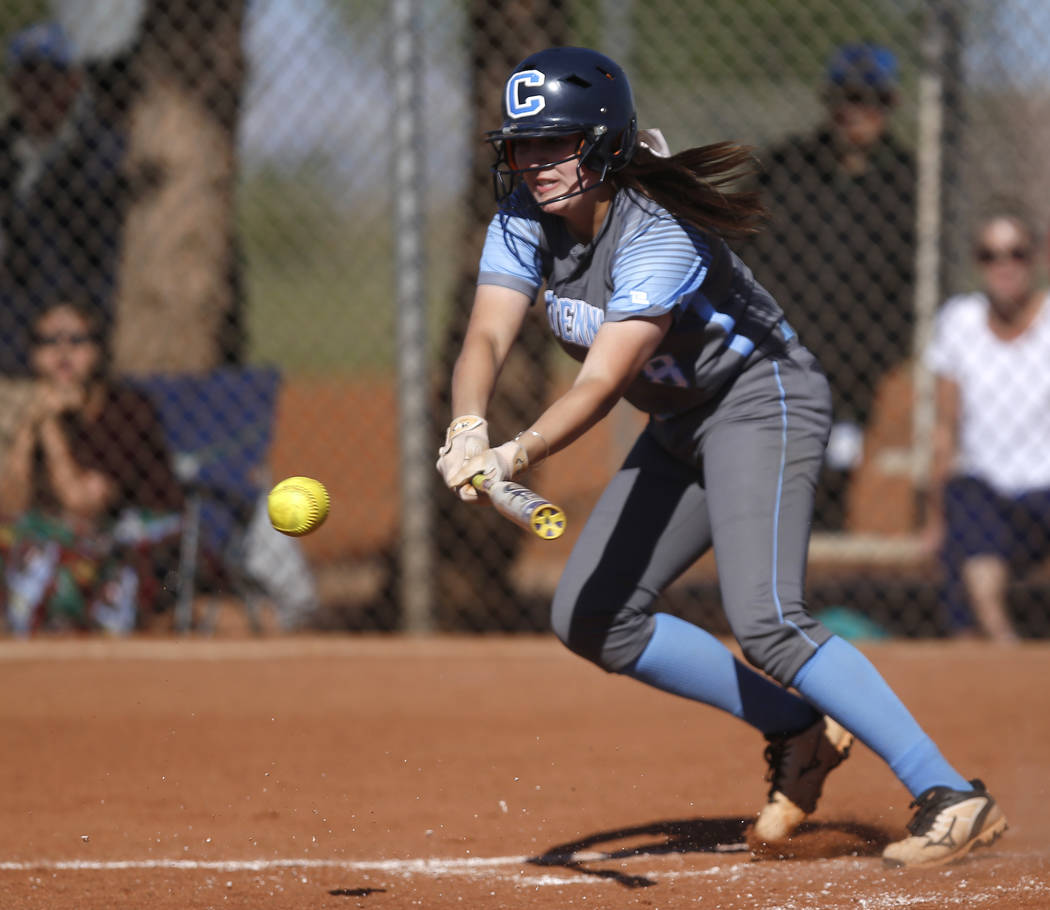 Centennial's Haylee Lupinetti (8) bunts during the second inning of a high school soft ...