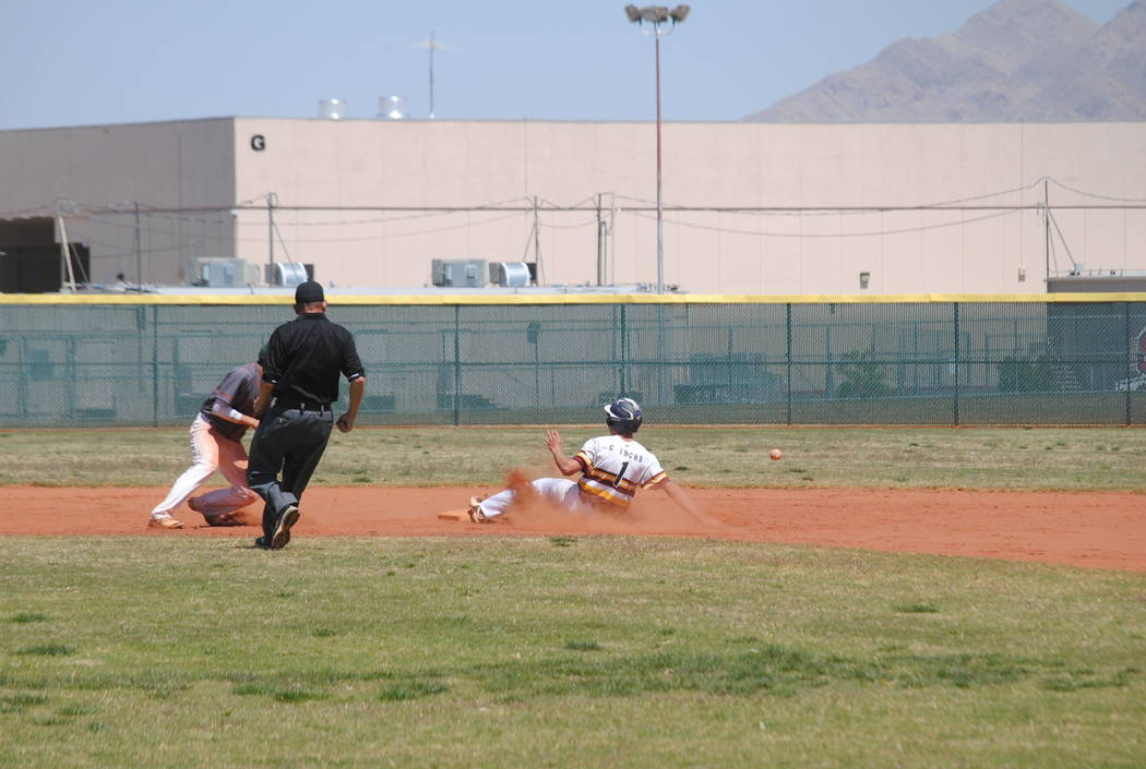 Pahrump Valley's Garrett Lucas slides safely into second base on Wednesday. The Trojan ...