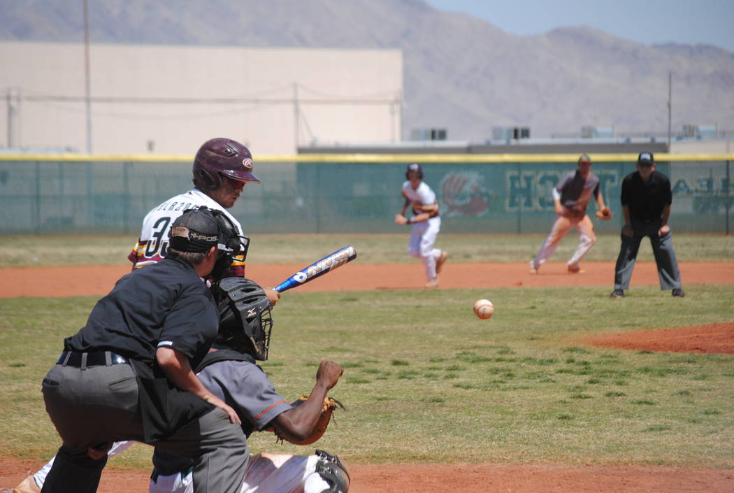 A Pahrump Valley player takes a pitch on Wednesday. The Trojans beat Mojave 5-0 to capture t ...