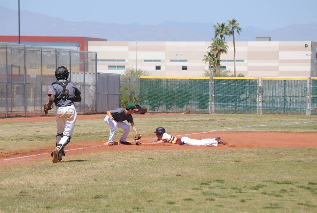 A Pahrump Valley player attempts to slide into third base on Wednesday. The Trojans beat Moj ...