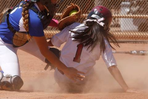 Desert Oasis's Yahirda Pelegrina (1) is tagged out at home plate during a high school ...