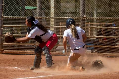 Shadow Ridge sophomore Shea Clements slides safely into home during a game against Banning a ...