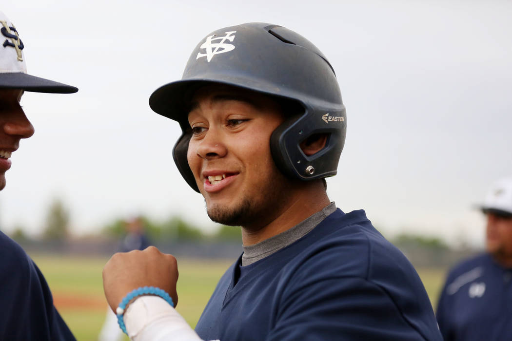 Spring Valley's Humberto Maldonado (33) fist pumps his teammates during a game against ...
