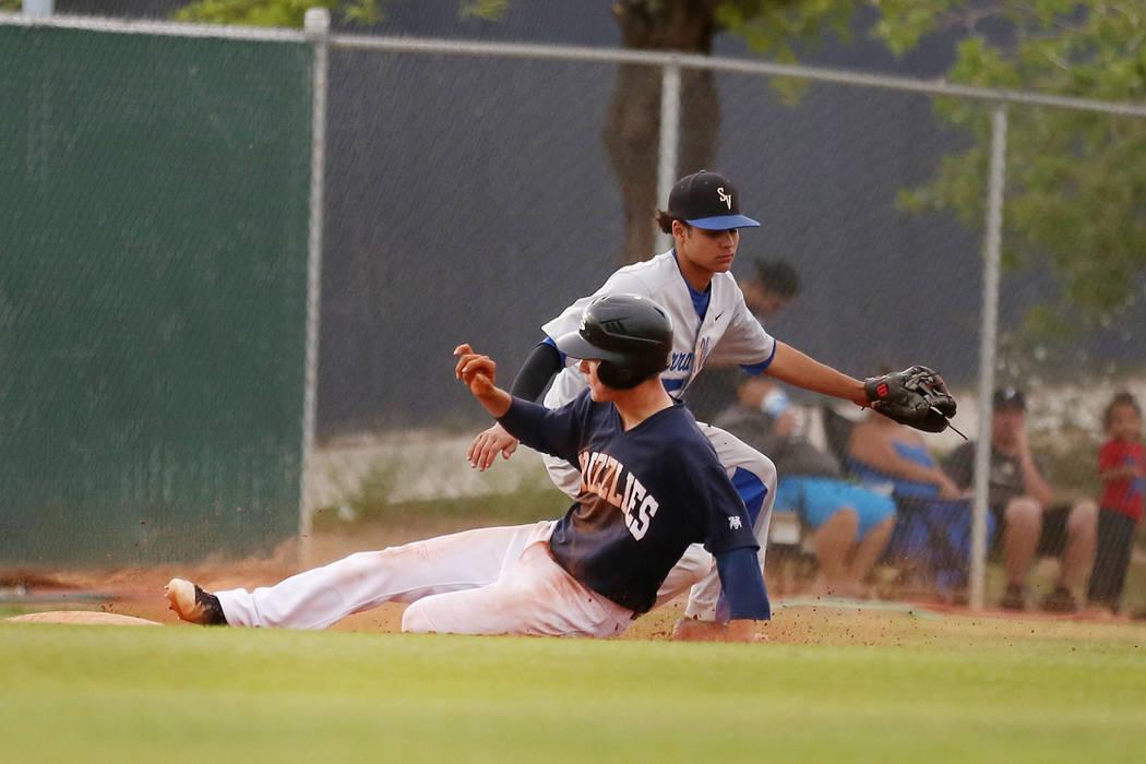 Spring Valley's Bryce Bullock is safe at third base against Sierra Vista High School a ...