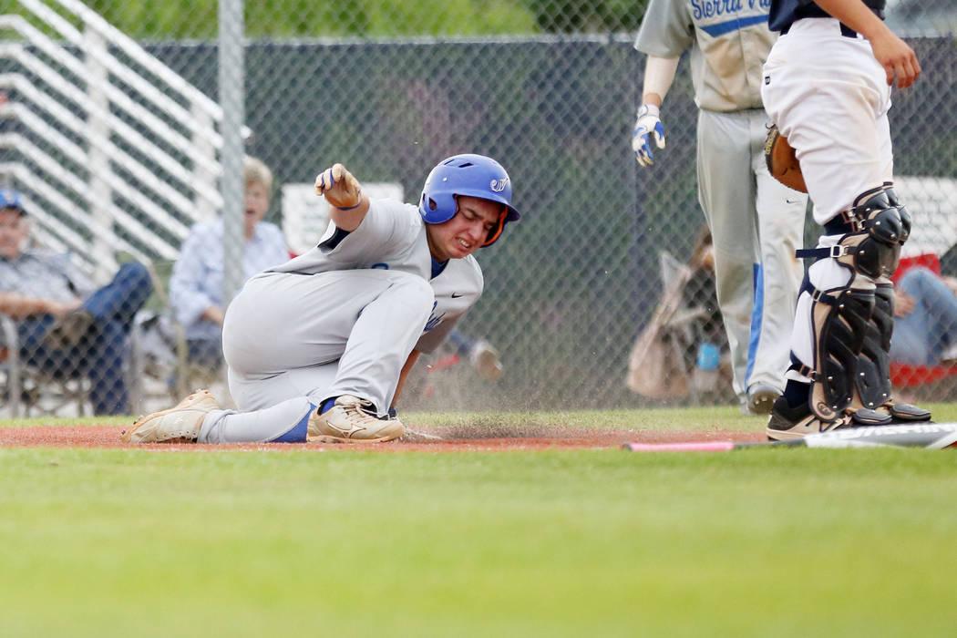 Sierra Vista's Matt Vanderberg slides into home during the fifth inning against Spring ...