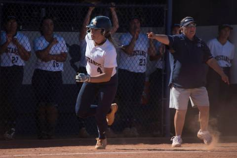 Shadow Ridge sophomore Shea Clements runs past her coaches and teammates into home during a ...