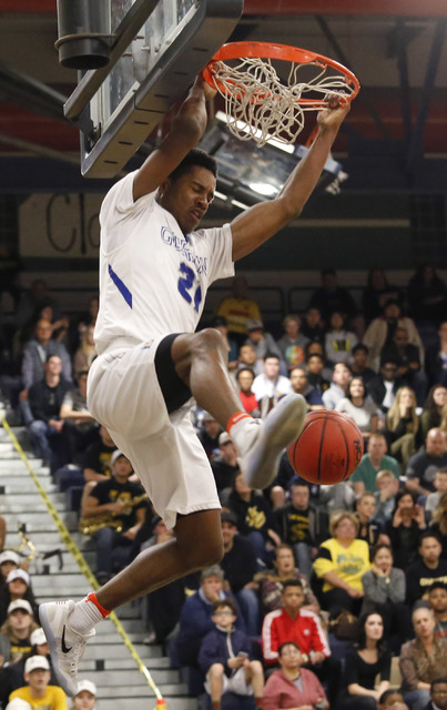 Bishop Gorman's Christian Popoola (21) dunks during the second half of a Class 4A Suns ...
