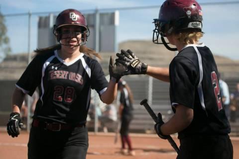 Desert Oasis senior Scarlett Hurtado, left, high-fives teammate senior Meagan Anders, right, ...