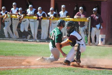 Pahrump Valley catcher Willie Lucas tags out Mojave's Reece McClian at Pahrump Valley ...