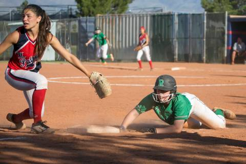 Rancho junior Gianna Carosone slides into third during the team's playoff game against ...