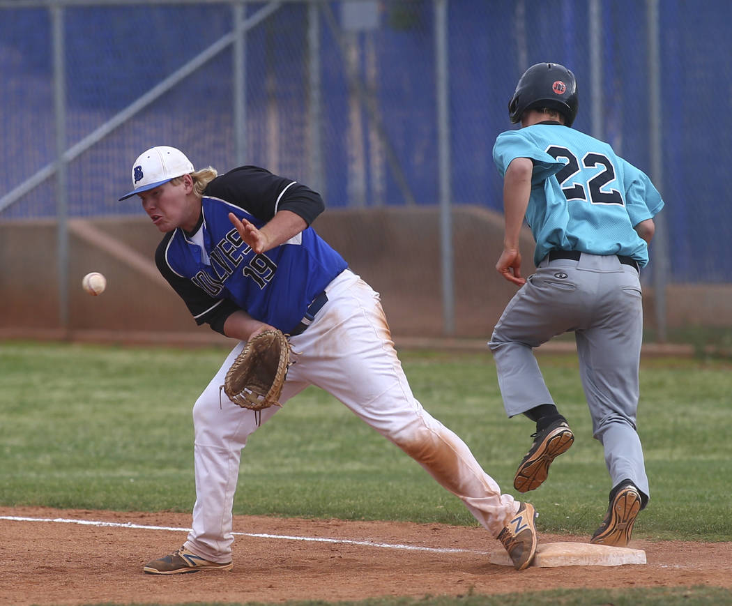 Silverado's Tyler Paasche (22) makes it to first base against Basic's Jack Wold ...