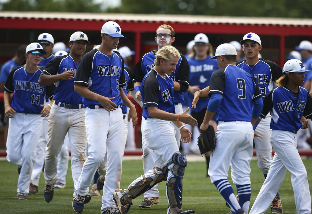 Basic players congratulate pitcher C.J. Dornak (9) after the team defeated Galena 12-0 in 5 ...