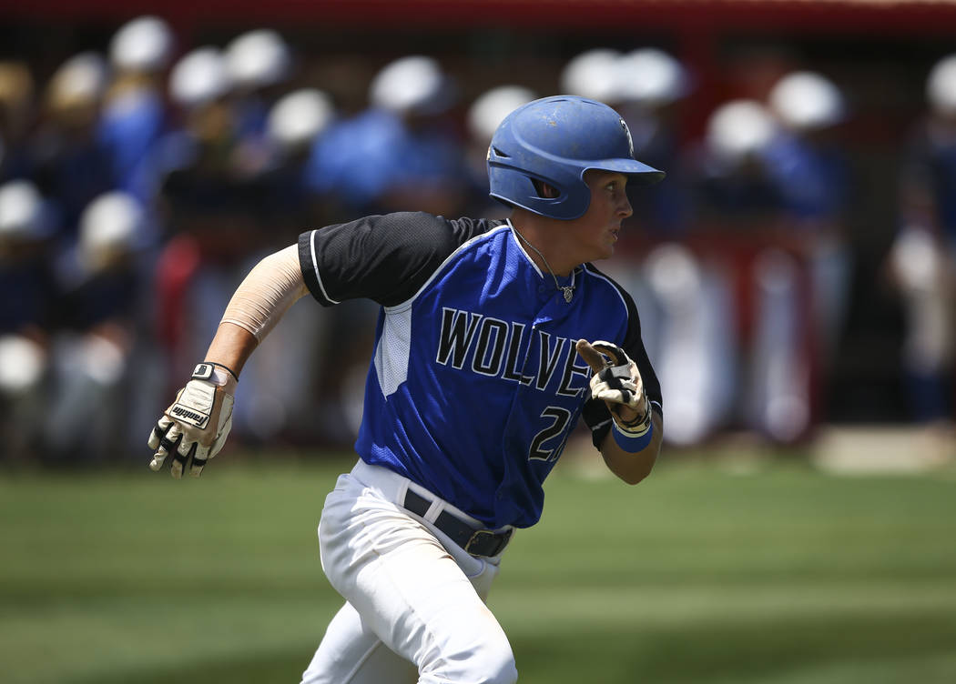 Basic's Paul Myro runs for first base during a Class 4A state baseball tournament game ...