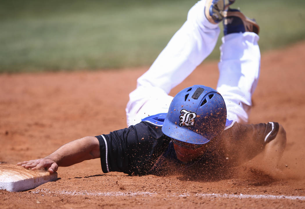 Basic's Nick Thompson stays safe at first base during a Class 4A state baseball tourna ...